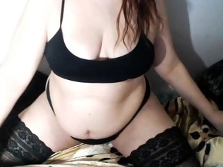 Young Cam Doll evapoison. redhead with big boobs