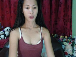 Asian sexykltten18 with brown eyes and shaved pussy